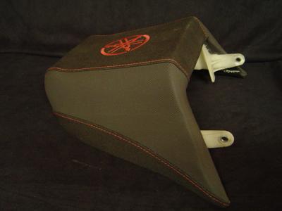 Passenger seat with logo tuning-fork